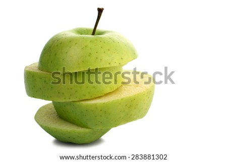 Isolated green apple slices - stock photo