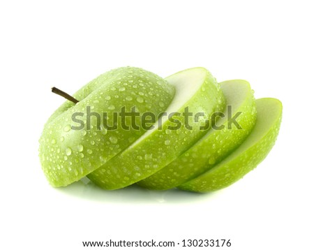 Isolated green apple slices with water drops (white background). Fresh diet fruit. Healthy fruit with vitamins. - stock photo