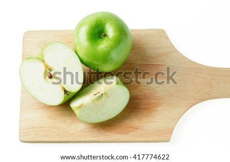 isolated green apple with clipping path and shadow which put on wood-pad.