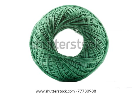 Isolated green cotton spool against white background