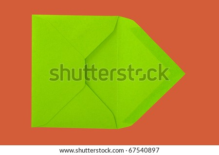 Isolated green envelope on the red surface with paths. - stock photo