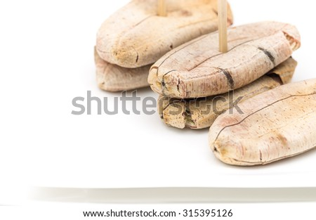 Isolated grilled banana on white ceramic plate for local Thai dessert background - stock photo