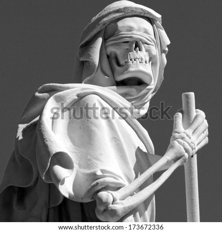 isolated grim reaper sculpture on cemetery  - stock photo