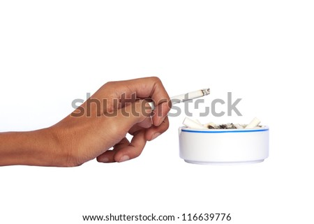 Isolated hand and ceramic ashtray with cigarettes. - stock photo