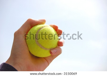 isolated hand holding a tennis ball