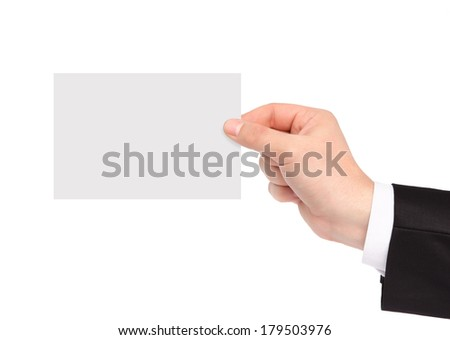 isolated hand of a businessman in a suit holding a piece of paper - stock photo