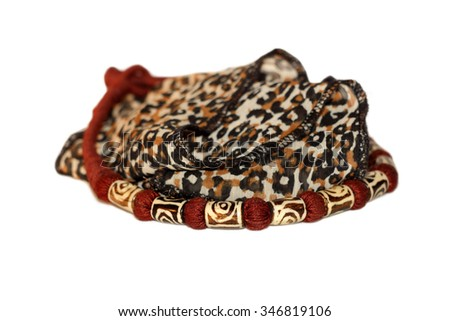 Isolated handmade collar necklace from Botswana with a leopard printed silk scarf.