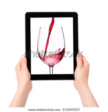 isolated Hands Holding Digital Tablet with Red wine splashing