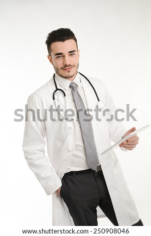 isolated handsome young student doctor with a stethoscope - stock photo