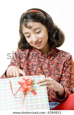 isolated happy latin girl with her christmas presents - stock photo