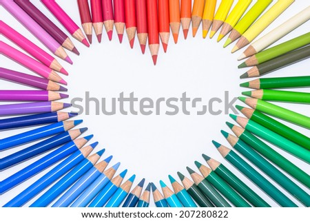 Isolated Heart made of Colorful Crayons - stock photo