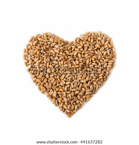 Isolated heart shape from ripe wheat seeds