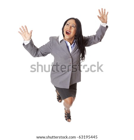 Isolated high angle full length studio shot of a Latina businesswoman looking up in fear with arms raised as if fleeing from a perilous situation. - stock photo