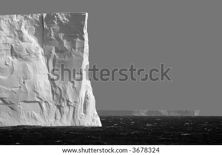 Isolated iceberg in grey - stock photo