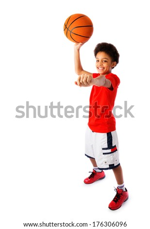 Isolated image of a African American teenager, basketball player being about to throw a ball - stock photo