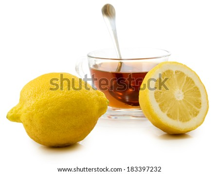 isolated image of a cup of tea and a lemon on a white background
