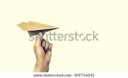 isolated image of a hand starts the paper plane - stock photo