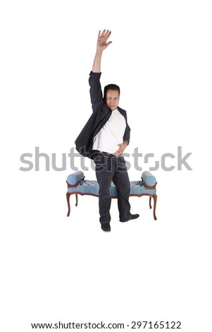 Isolated image of a handsome hispanic man dancing - stock photo