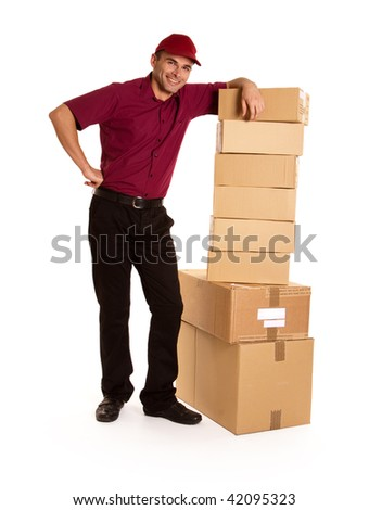 Isolated image of a messenger in red delivering a lot of boxes - stock photo