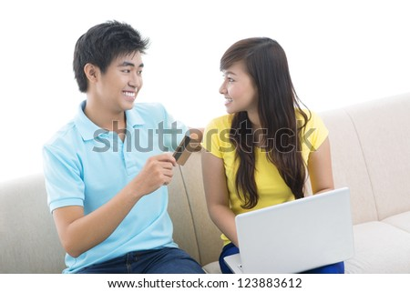 Isolated image of a modern couple being busy with online shopping - stock photo