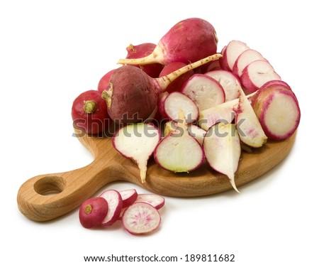 Isolated image of a radish on board closeup - stock photo