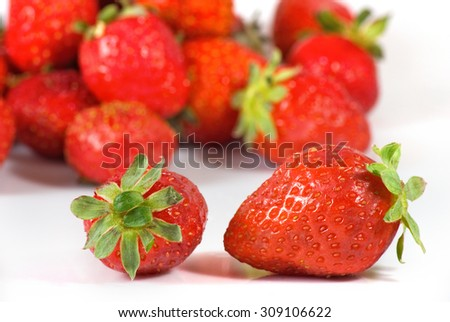 Isolated image of a ripe strawberry on a white background  - stock photo