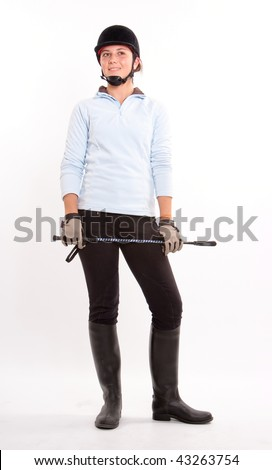 Isolated image of a teenage girl dressed in horse riding clothes - stock photo