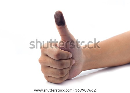 Isolated image of a thumb with ink stain getting ready to make a print. - stock photo