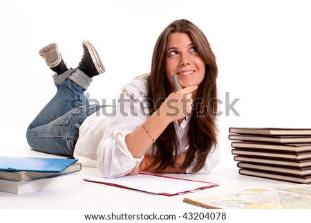 Isolated image of a Young girl studying geography lying on the floor - stock photo