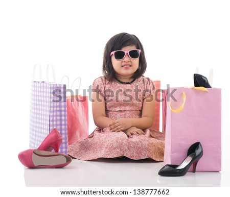 Isolated image of an upset little lady tired of shopping - stock photo