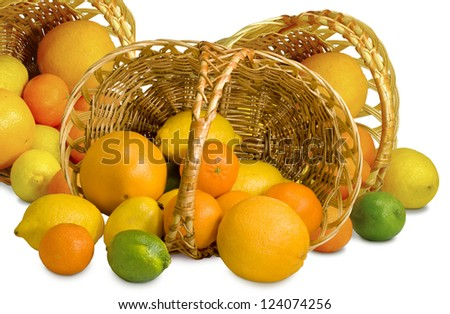 Isolated image of citrus fruits in three  basket on a white background - stock photo