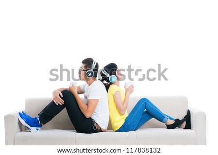 Isolated image of cool teens enjoying music and hot drinks - stock photo