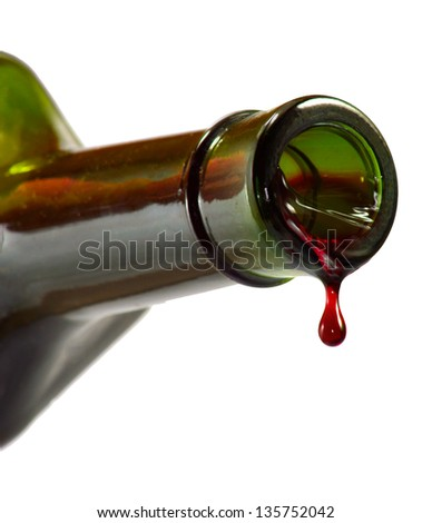 Isolated image of drop of wine from a bottle on a white background - stock photo