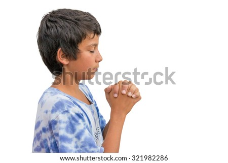 Isolated image of gypsy christian child having devotional time in church pray to god and jesus - stock photo