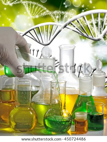 Isolated image of laboratory glassware on the genetic chain  background closeup - stock photo