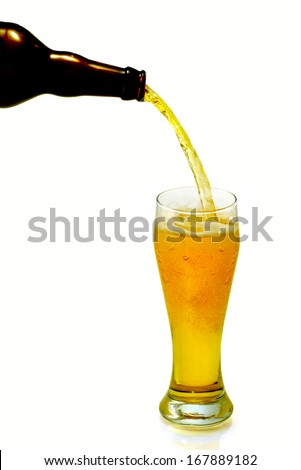 Isolated image of pouring beer from a bottle in a mug - stock photo