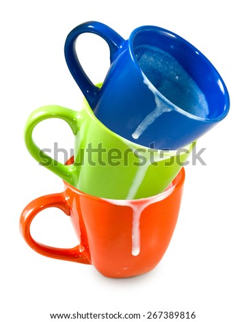 Isolated image of three empty dirty cups - stock photo