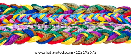 Isolated image of twisted floss threads on white background