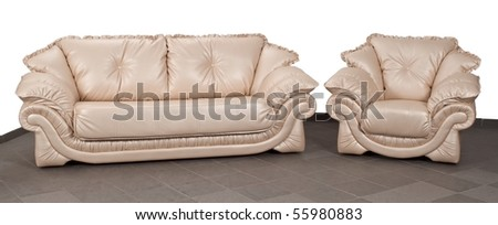 Isolated leather sofa and chair on tile