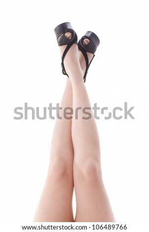 Isolated legs with black shoes on white background - stock photo