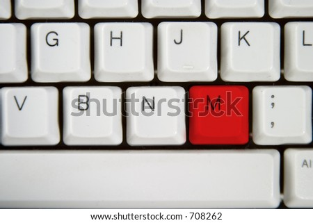 Isolated letter M on from a computer desktop keyboard highlighted in Red