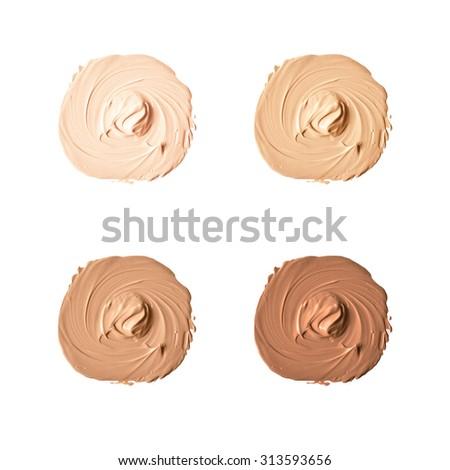 Isolated liquid foundation samples set - stock photo