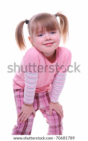 isolated little girl smiling wearing pink - stock photo