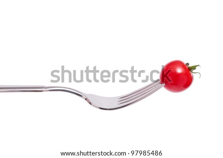 Isolated little red cocktail tomato with a fork