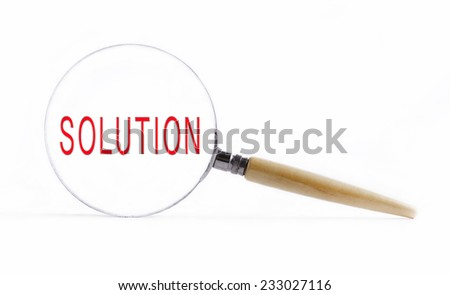 "Isolated Magnifying glass on white background searching missing puzzle peace ""SOLUTION"" - stock photo"