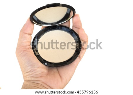 isolated makeup pressed powder in women's hand