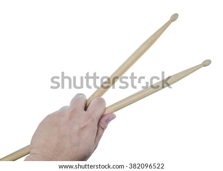 Isolated male left hand holding drum sticks on white background