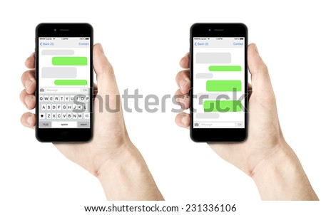 isolated man hand holding the smartphone with sms chat on a screen - stock photo