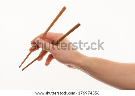 isolated man hand holding wooden chopstick - stock photo