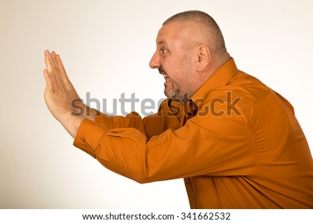 Isolated man pushing copy space - stock photo